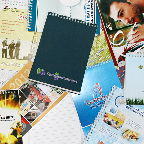 Блокноты и брошюры